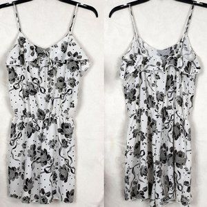 Blue S black and white floral romper. Flowy ruffle